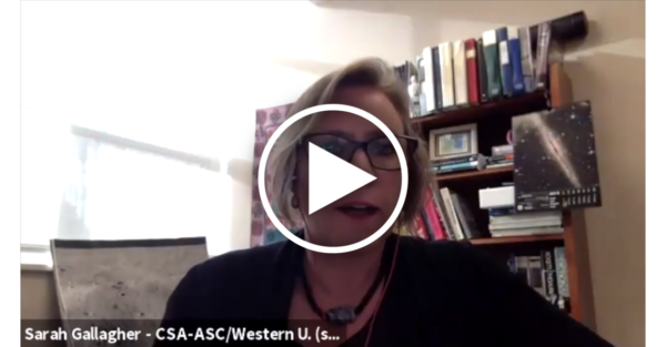 screenshot of a white woman talking, with a play button overlaid