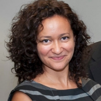 Photo of a white woman with curly hair
