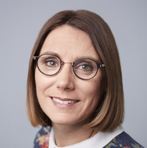 headshot of a white woman with glasses