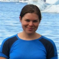 photo of a white woman in front of an artic bay