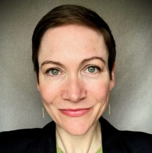 headshot of a white woman with short hair