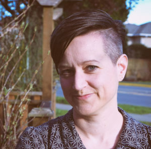 photo of a white woman with short hair and an undercut