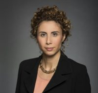 headshot of a white woman with curly hair