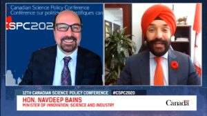 Screengrab and on interview with a white man in glasses (Mehrdad Hariri) and a sikh man in a turban (Navdeep Bains)