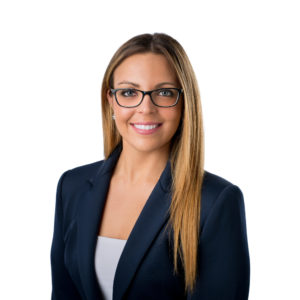 a headhot of a white woman with glasses in a suit